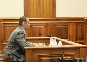 Jeremy Tripp, MCO director of government and political affairs, testifies before the legislature on a bill.