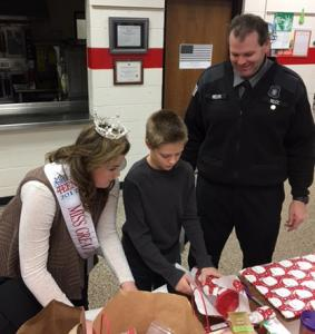 Jackson-area COs helped Blackman Township police with their Shop with a Cop program last year. Shop with a Cop is just one way officers give back to their communities. CO Melvin and his daughter, Izzy Melvin, Ms. Great Lakes Outstanding Teen, helped the kids shop and wrap gifts. Photo by Sheila Melvin.
